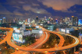 Freeway in night with cars light in modern city — Stock Photo