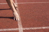Athlete in the starting blocks, ready to go  — Stock Photo