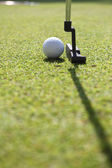 Golf club and ball. Preparing to shot — Stock Photo