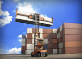 Crane lifting up container in railroad yard — Stock Photo