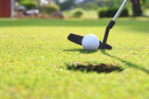 Golf club and ball. Preparing to shot — Stock Photo