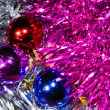 Christmas balls with tinsel — Stock Photo #13161557