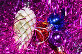 Christmas tinsel with cone — Stock Photo