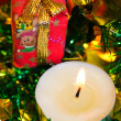 Candle with christmas green tinsel — Stock Photo #13392789
