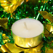 Candle with christmas green tinsel — Stock Photo #13398168