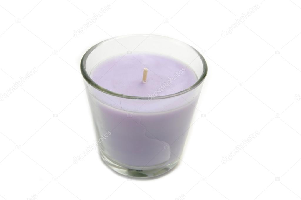Candle in a glass beaker on a white background  Stock Photo #13127986