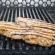 Catfish meat on the grill - Stock Photo