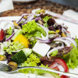 Greek salad on a table in a restaurant — Stock Photo #13407327