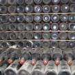 Stock Photo: Cellars with wine bottles