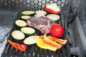 Cooking steak and vegetables — Stock Photo