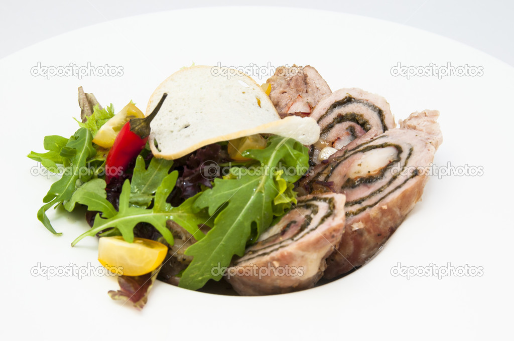 Roll meat with herbs and vegetables on a white plate  Stock Photo #14662077