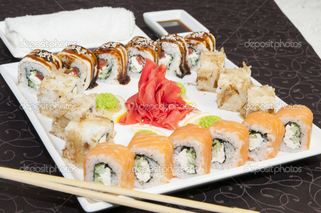 Japanese sushi on a table in a restaurant — Stockfoto #14666201