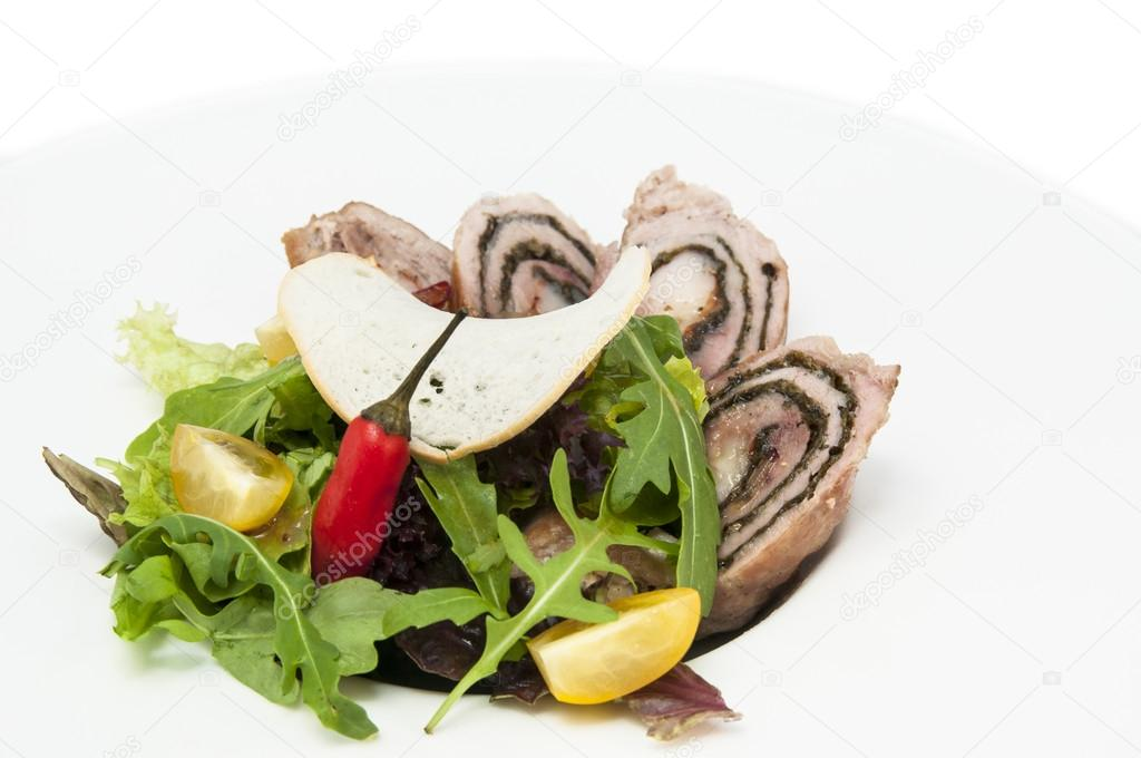 Roll meat with herbs and vegetables on a white plate — Stock Photo #14881437