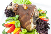 Roasted pork knuckle with vegetables — Stock Photo