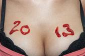 Numéros sur la poitrine de la femme — Photo