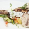 Rabbit meat and potatoes - Stock Photo
