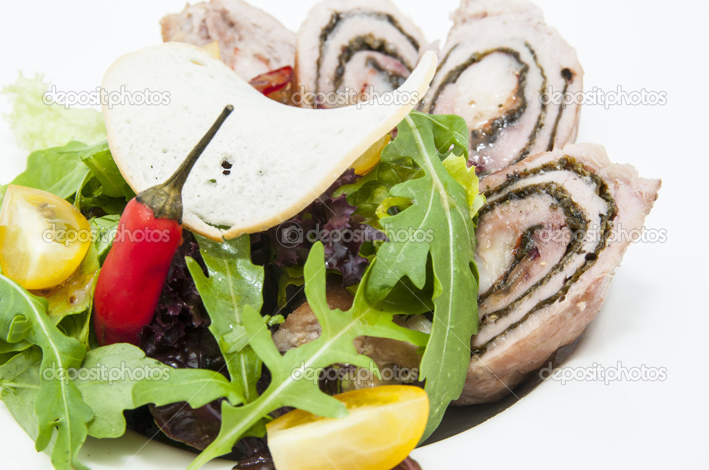 Roll meat with herbs and vegetables on a white plate — Stock Photo #17702109