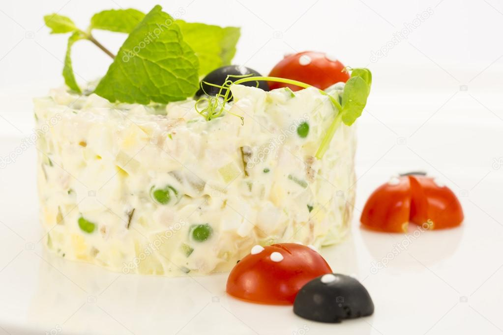 Olivier salad decorated with tomato in the shape of ladybugs — Stock Photo #19152733