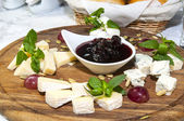 Plate with cheeses — Stock Photo