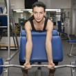 Sportswoman works out with dumbbells — Stock Photo