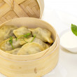 Foto Stock: Bamboo steamers with gyozand baozi dumplings