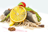 Baked fish with spaghetti — Stock Photo