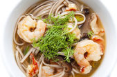 Soup with shrimp and pasta — Stock Photo