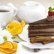 Stock Photo: Piece of cake with cup of tea