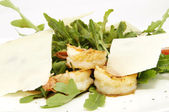 Arugula dish with shrimp in a restaurant — Stock Photo