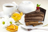 Piece of cake with a cup of tea — Stock Photo