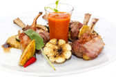 Roasted veal ribs with vegetables — Stock Photo