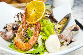 Salad with vegetables and seafood — Stock Photo