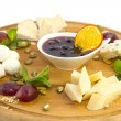 Cheese plate with several varieties of cheese — Stock Photo