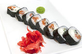 Japanese rolls with fish and vegetables — Stock Photo