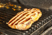 Cooking meat on the grill — Stock Photo