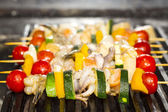 Cooking skewers of seafood — Stock Photo