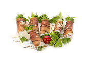 Rolls of meat and greens on a white background in the restaurant — Stock Photo