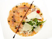 Carpaccio of salmon on a white background in restaurant — Stock Photo