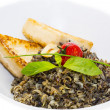 Black rice and baked cheese — Stock Photo