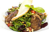 Rabbit liver salad with arugula in a restaurant — Stock Photo
