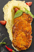 Cutlets fried in carrot sauce with mashed potatoes — Stock Photo