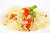 Pasta with fish red caviar and cheese on the table in a restaurant — Stock Photo