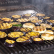 Cooking vegetables on the grill in the restaurant — Stock Photo #26170141