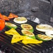 Cooking vegetables on the grill in the restaurant — Stock Photo #26336309
