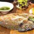 Sea fish cooked on the grill — Stockfoto