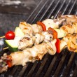 Stock Photo: Skewers of seafood grilling