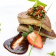 Roast goose liver is decorated with greens and strawberries — Stock Photo