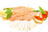 Slices of salmon with herbs and cheese — Stock Photo