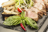 Meat roasted on a grill with vegetables — ストック写真