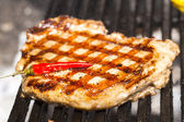 Beef steak cooking on the grill — Stock Photo